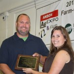 Producer Roddy Purser is awarded the 2012 Anson County Outstanding Farmer of the Year by Ag Agent Jessica Anderson.