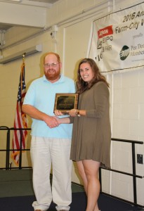 JessicaMorgan, Agricultural Agent, presents the Outstanding Farmer of the Year Award.
