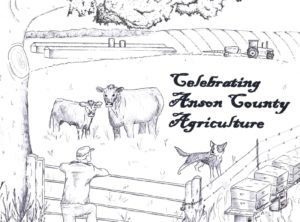 Drawing of a farmer leaning on his fenced pasture with cows and a dog. This is the drawing used on the tshirt